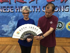 Presentation of fan to club by Chinese delegation representative